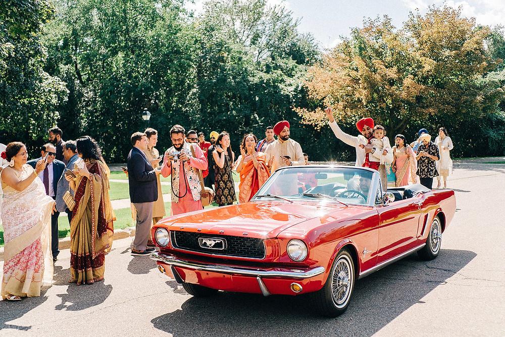 baraat entrance groom driving mustang convertible
