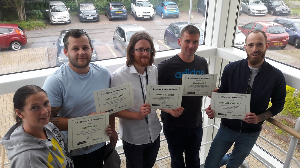 This is a picture of the 5 staff holding their certificates having completed their training course