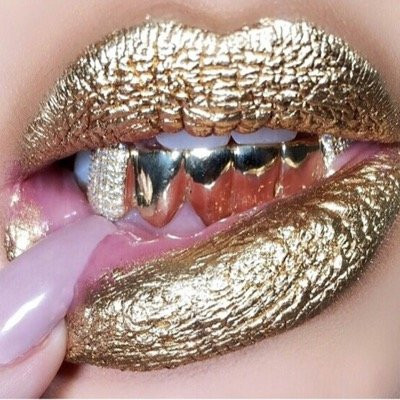 woman with gold grill