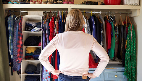 1140-woman-looking-at-closet.imgcache.re