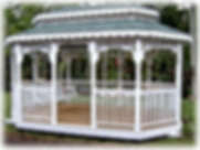 Glader Gazebo with swings and green Asphalt Shingal roof painted white Yoder Handcraft