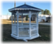 Octogon Gazebo with green roof with swinging door painted white Yoder Handcraft