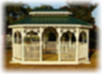 Glader Gazebo with swings and green Metal roof painted white Yoder Handcraft