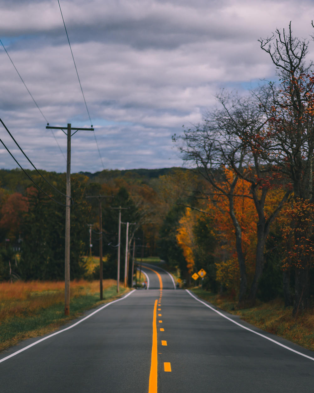 Fall foliage in Hunterdon County lines a steeply dropping back road