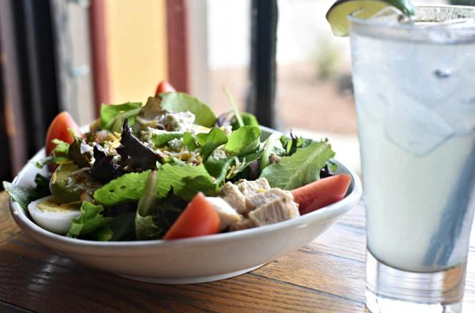 Fresh salad and lemon water