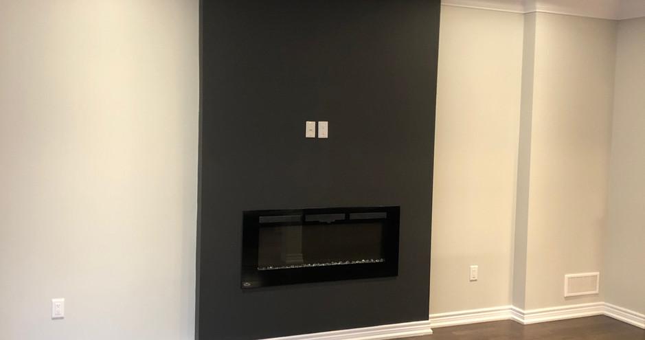 Sleek, Modern Basement Fireplace