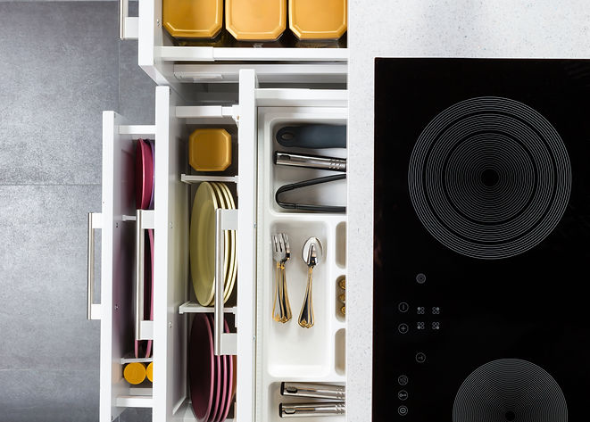 Top view of organized kitchen drawers an
