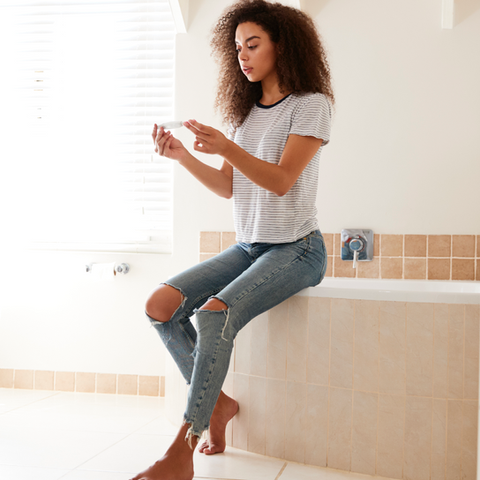 concerned-woman-in-bathroom-with-home-pr