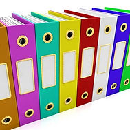 Multi-coloured files standing