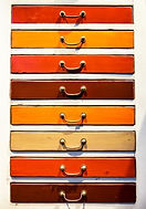 red, brown, orange, cream drawer fronts with gold handles