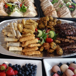 A full buffet with small cakes
