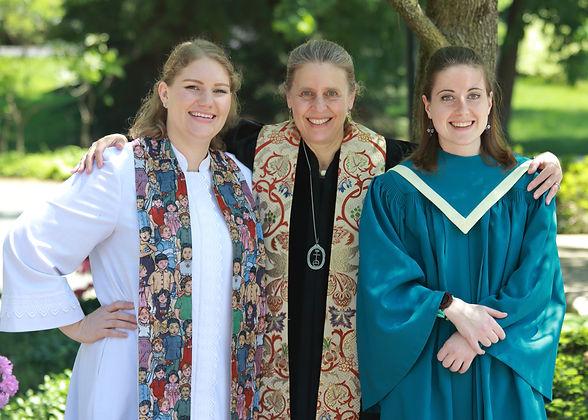 Pastor Peggy, Dr. Duke & Ms. Hazel in robes huddling together