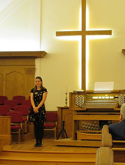 Hazel standing next to the Organ at her recital