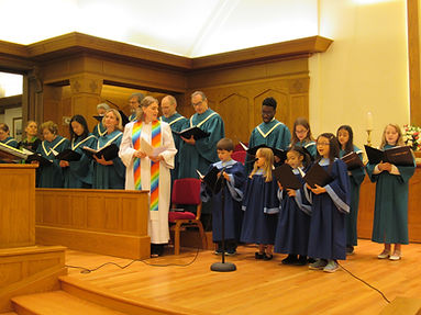 adult and kids choirs singing together for music ministry sunday