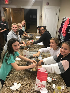 youth making cookies for college care packages