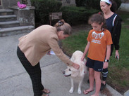 Blessing of the Animals with a dog and their owners being blessed