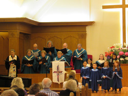 adult and kids choirs singing together