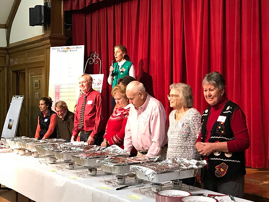 Holiday Dinner of Sharing food serving line of church volunteers