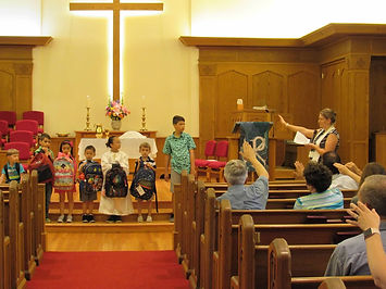 Blessing of the Backpacks during worship