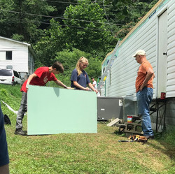 Appalachia Service Project Trip group working outside with drywall