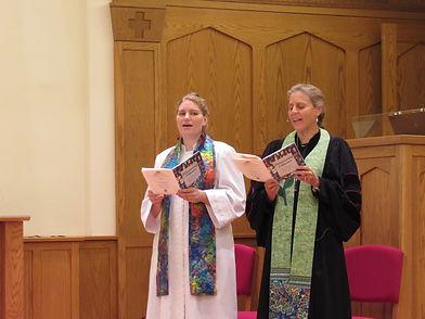 Pastor Peggy & Dr. Duke singing during worship