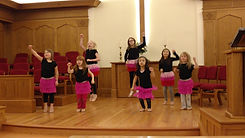 kids dressed up in tutus dancing during worship