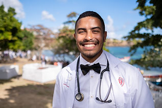 Male student in a white coat with a bow tie.jpg