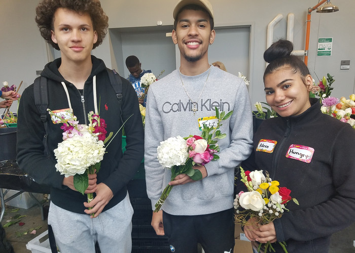 Youthbuild RI kids learning about flower arranging at a recyling event