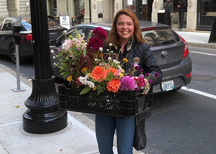 Delivering flowers to a charity event