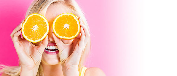 """Smiling woman holding orange slices in front of her eyes. """"Fresh. Zesty. Yeah... we do that."""""""