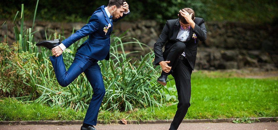 Groom and bestman dancing and goofing ar