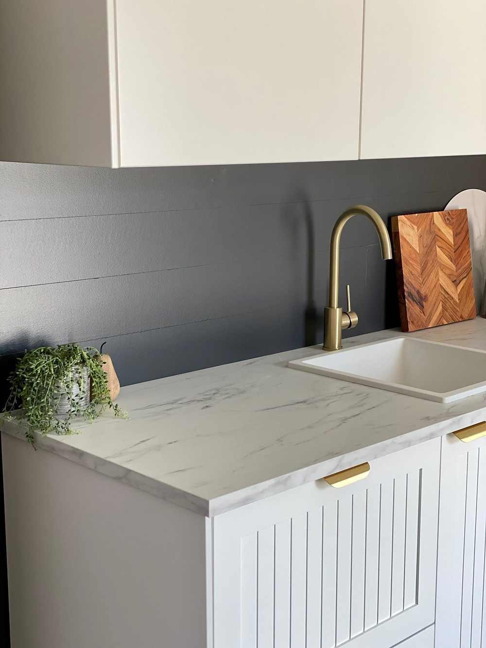 IKEA Metod kitchen cupboards with Customea's Shake The Line fronts and brass handles