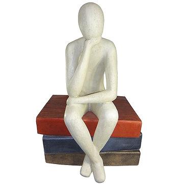 Sitting Man On Books Statue