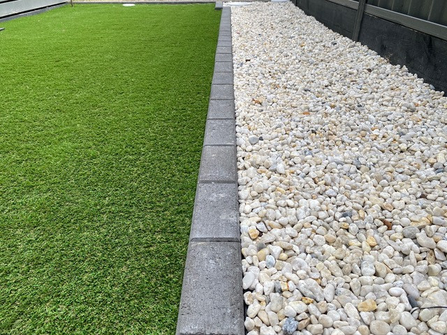 synthetic grass and pebble borders