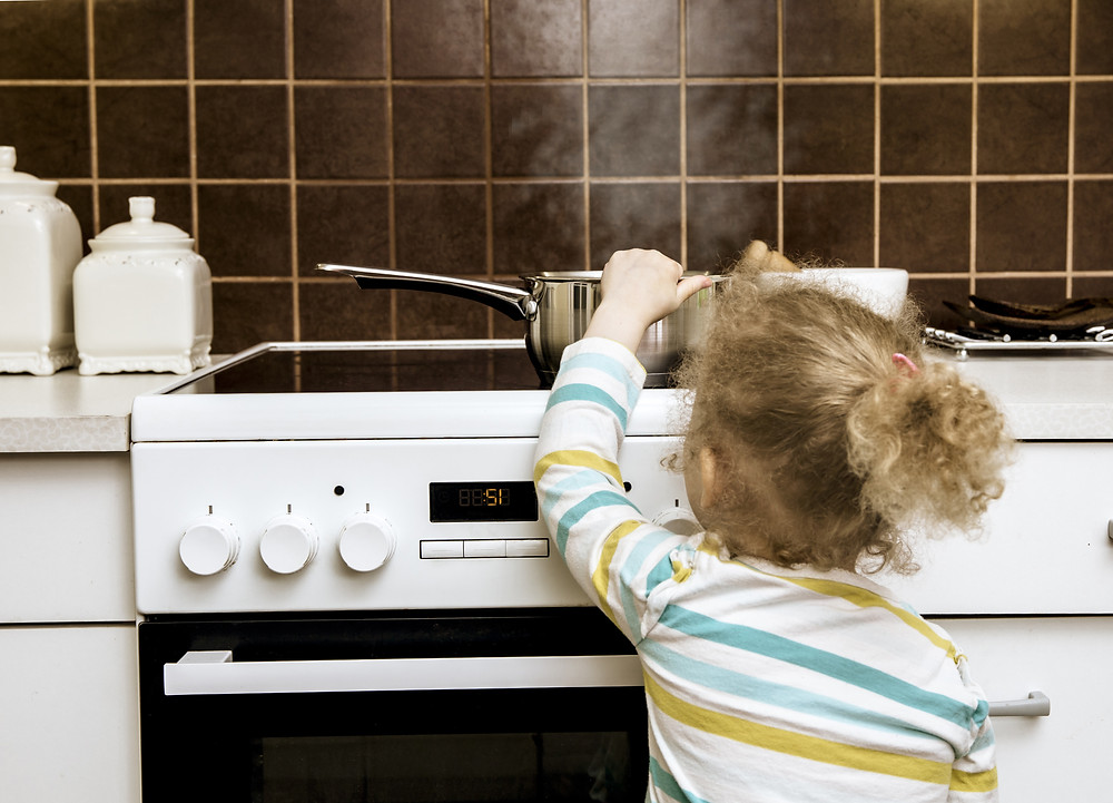 child-stovetop