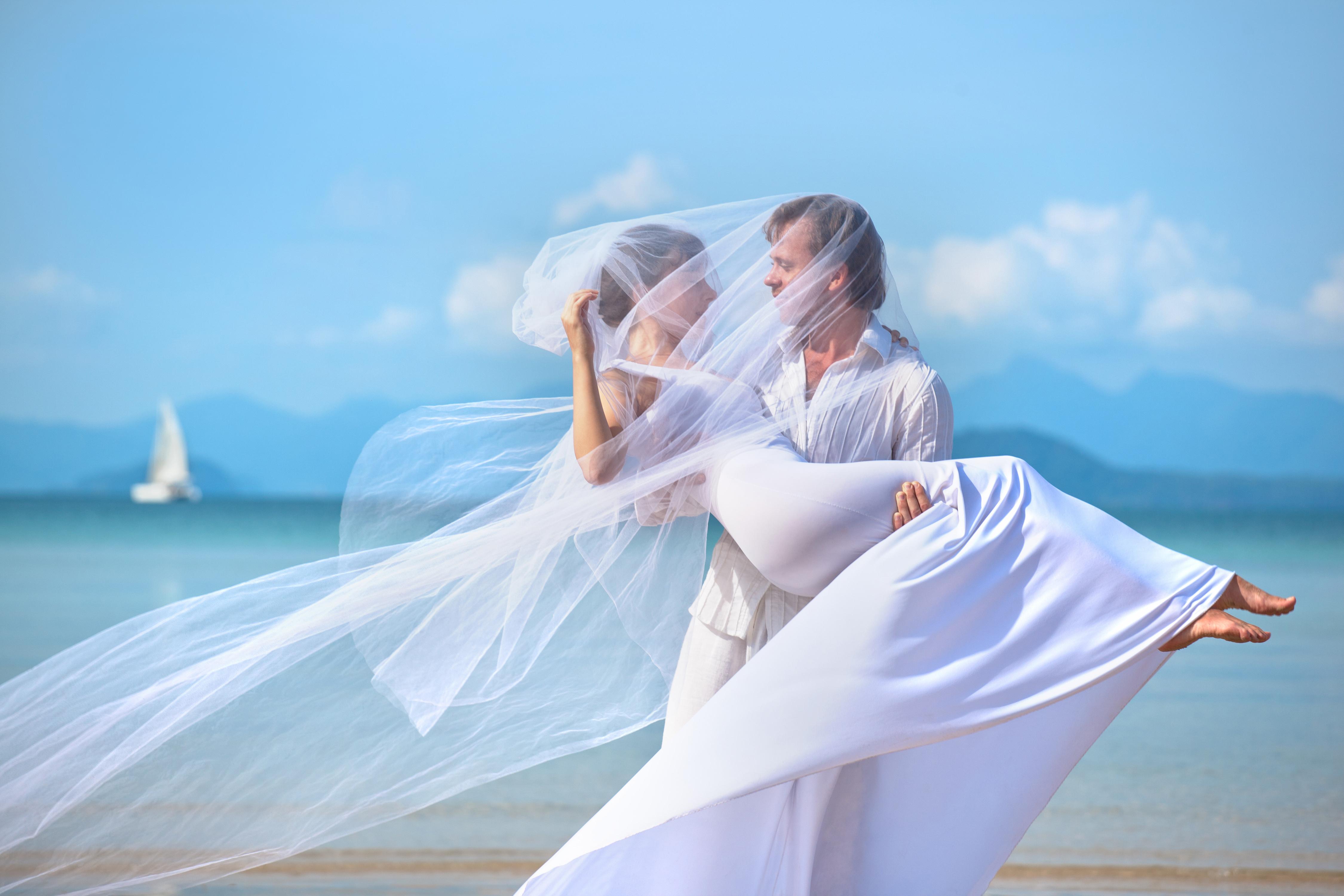beautiful couple on the beach in wedding