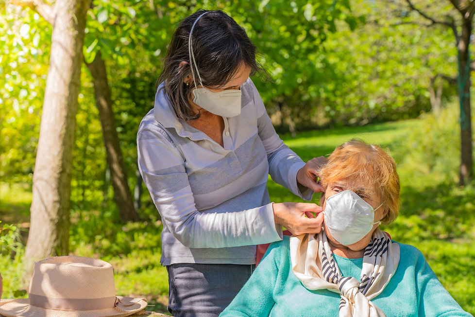 Caregiver with Mask Helping.jpg