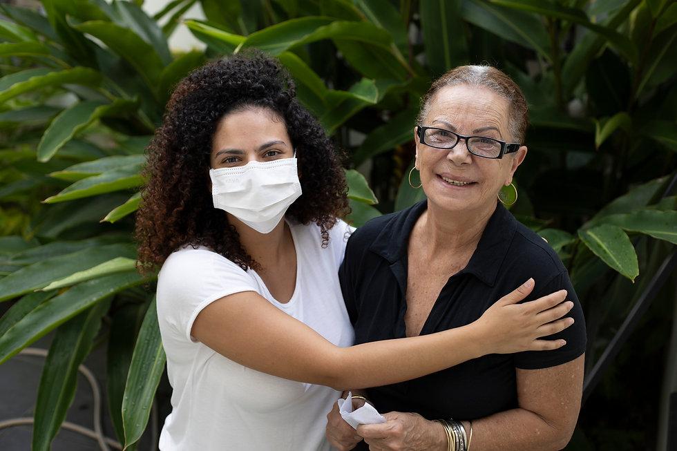 Caregiverr with Mask Hugging.jpg