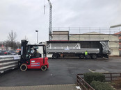 Metal insulated roof being delivered