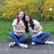 Caroline & Katherine in The Friendly Bookshelf T-shirts Holding The Friendly Bookshelf Plushies!