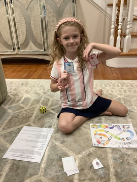 Addie plays The Blossom Shoppe Board Game