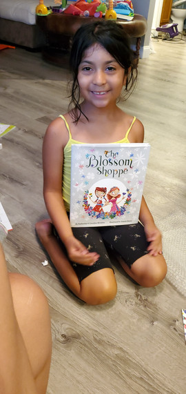 """Yael with her very own copy of """"The Blossom Shoppe""""!"""