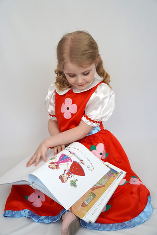"""Miriam from Texas reads """"The Blossom Shoppe"""" in her Poppy dress!"""