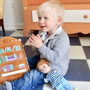 Child with Bibli Plushies 4