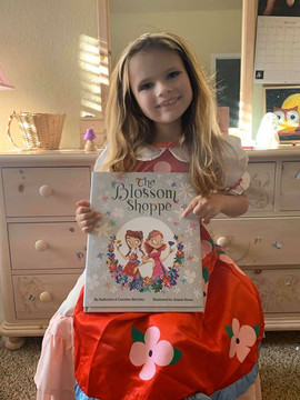 """Emily with her """"The Blossom Shoppe"""" book & costume bundle!"""