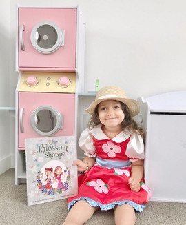 """Izary Perea with her """"The Blossom Shoppe"""" book & costume bundle!"""