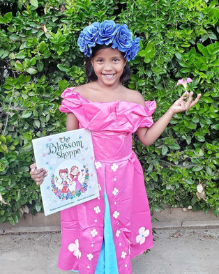 """Lily with her """"The Blossom Shoppe"""" book & costume bundle!"""