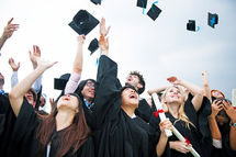 group-diverse-grads-throwing-caps-up-sky