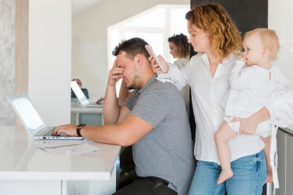 tired-father-working-laptop_23-214853643