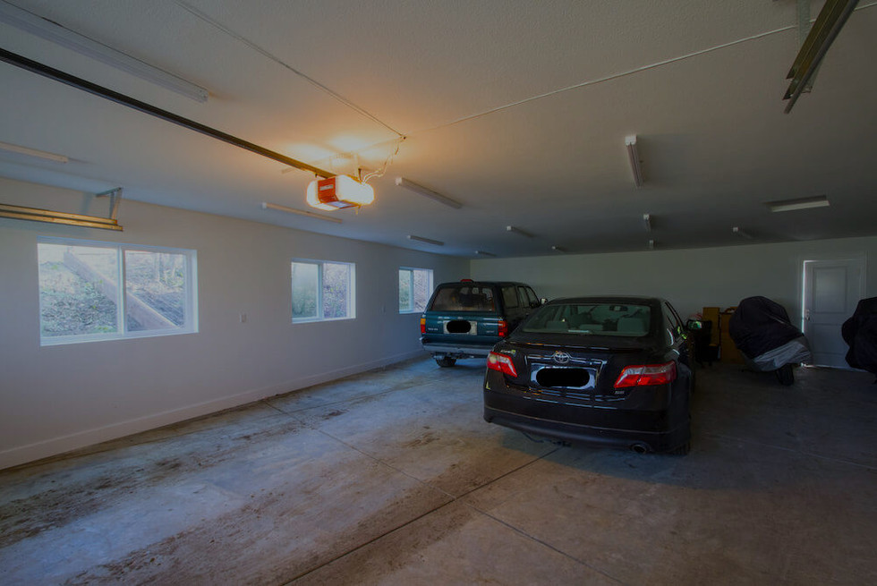 The four-car garage is the star of the show.